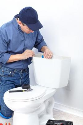Mike is working on repairing a toilet