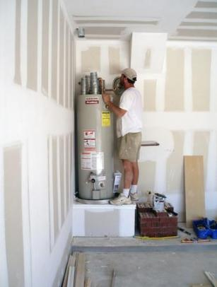 Plumbing professional installs a 40 gallon storage water heater